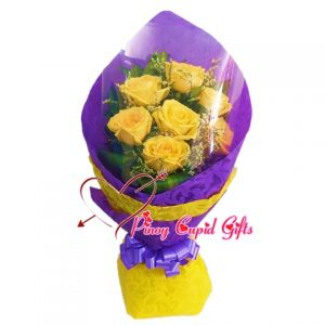 7 Yellow Imported Roses in a hand bouquet
