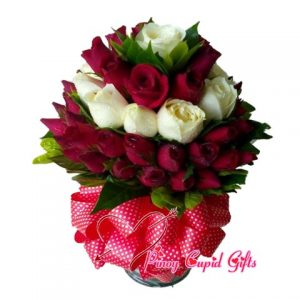 20 Imported Red and 10 Imported White roses in a vase.