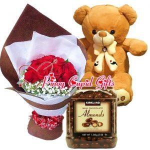 1 Dozen Red Roses Bouquet, 2 FT Brown Teddy Bear, Kirkland Almonds Chocolate (1.36kg)