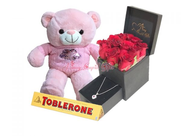 roses in romantic box with necklace, chocolate and teddy bear