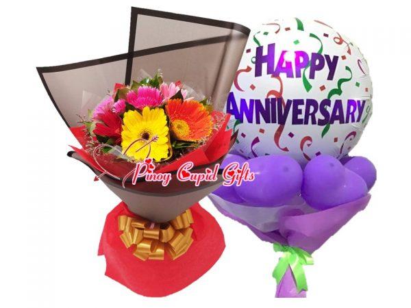 mixed gerberas and anniversary balloons