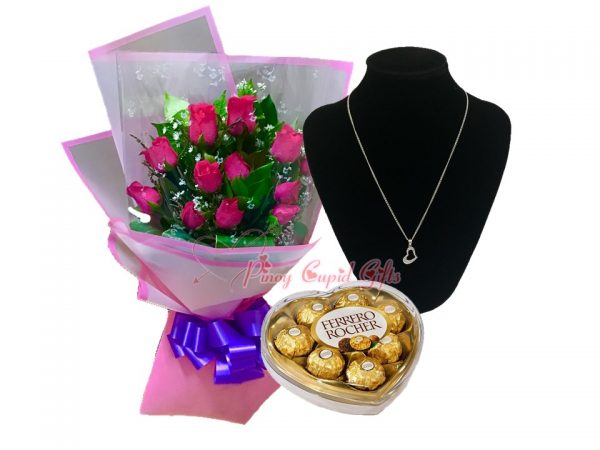 roses, ferrero chocolate, and silver necklace