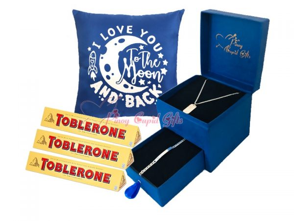 romantic box with silver dog-tag and bracelet, toblerone chocolates and message pillow