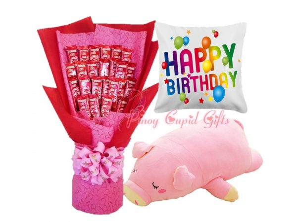 KitKat bouquet, stuffed toy, and birthday pillow