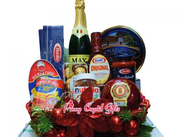 Christmas Basket09: Spaghetti, Pasta Sauce Grape Juice, Ham, Corned Beef, BBQ sauce, Cookies, Nutella, Queso de Bola Ham