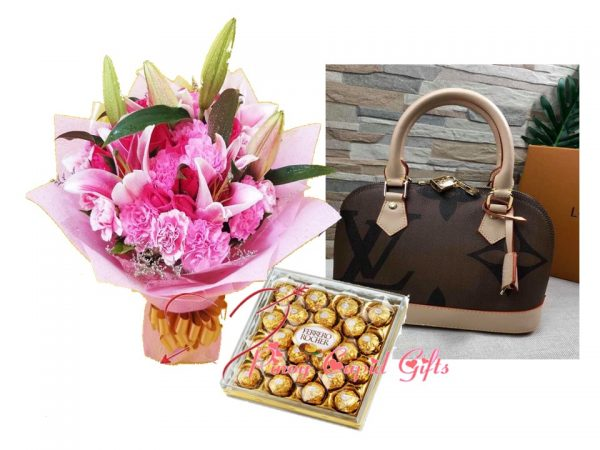 mixed carnation/lilies, ferrero chocolates and ladies bag