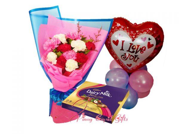 mixed carnations, cadbury chocolates and balloons
