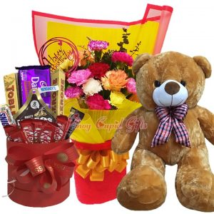 3 FT Brown Teddy Bear, Mixed Carnations Bouquet, Assorted Chocolates in a Bucket: (Toblerone 100gx2, Cadbury 165g, 1 Sneakers, 1 Hersheys' Nuggets, KitKat-8pcs, Hershey's Kisses-40g)