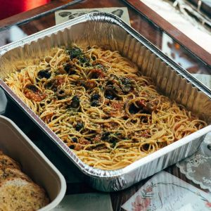 Spaghetti noodles with a homemade tomato sauce , olive oil and with premium quezo de bola